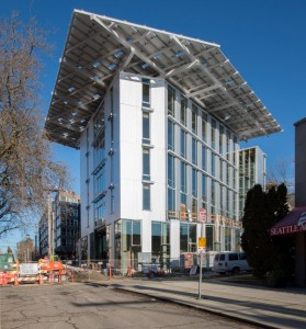 The Bullitt Center, here still being finished, has a 242-kW solar system on its roof, manufactured by HatiCon Solar.