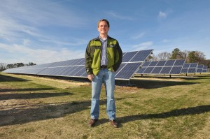 Trey Hill, Partner, Harborview Farms, stands in front of the 200 kW solar array at the Sustainable Agriculture Celebration at Harborview Farms on Dec. 6, 2012 in Rock Hall, Md. Harborview Farms is one of the largest and most sustainably driven farming operations in Maryland. (Larry French/AP Images for DuPont)
